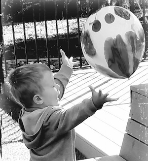 Child playing with a ballon